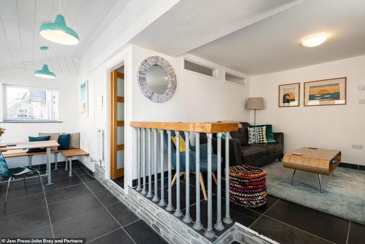 Inside, the property boasts a pretty open-plan living and dining room area and a galley kitchen. Both the master and double bedrooms come with an en-suite bathroom
