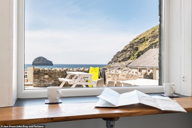 Recently refurbished, the ground-floor home has glorious views of the stunning coastline, withtwo private sea-facing terraces with uninterrupted westerly views across Trebarwith Strand