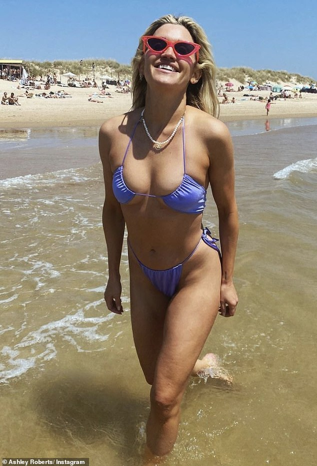 Careful!Ashley Roberts, 39, risked falling out of her tiny bikini as she frolicked in the water while enjoying a beach day in Portugal, on Monday