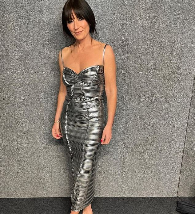 Gorgeous:Davina McCall, 53, made sure her gym-honed physique was on full display, slipping into a figure-hugging metallic gown and also opting for shimmery strap heels