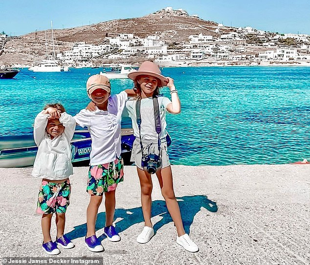 On an adventure: The children, Vivianne, seven, Eric, five, and Forrest, three, looked ready for anything in a separate post in which they posed in front of the sparkling cool blue water