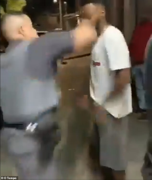 Still image of a video that captured Corporal Oliveira of the São Paulo (Brazil) Military Police punching Kaio Souza moments after a traffic stopped turned violent Saturday.Oliveira, a white man, allegedly called Souza, who is a black man and the other two individuals who were being questioned, 'n****'