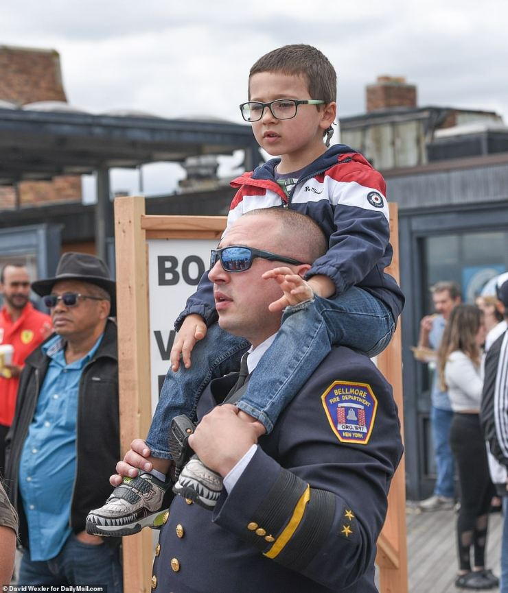 Wantagh, New York: A firefighter and his son watched the skies as U.S. Air Force pilots performed tricks and stunts for the crowd