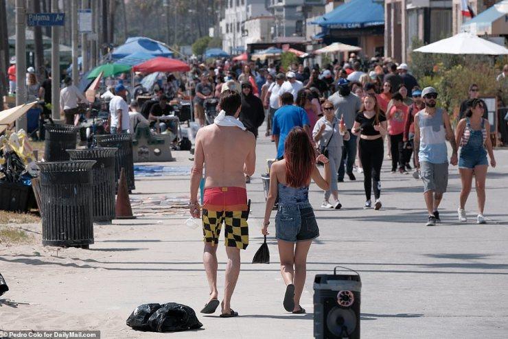 Venice Beach, California: A couple walked down the boardwalk on Monday