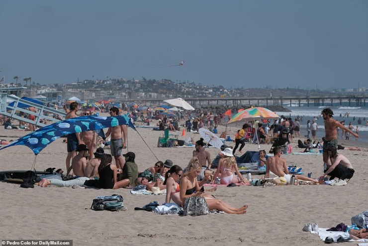 Venice Beach, California: Beach-goers laid out on the sand on Memorial Day