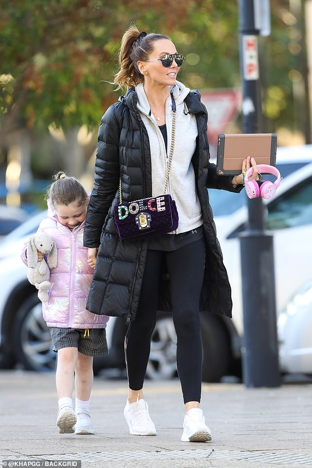 Style queen! Kyly looked effortlessly stylish in a grey goodie, leggings and chic puffer coat