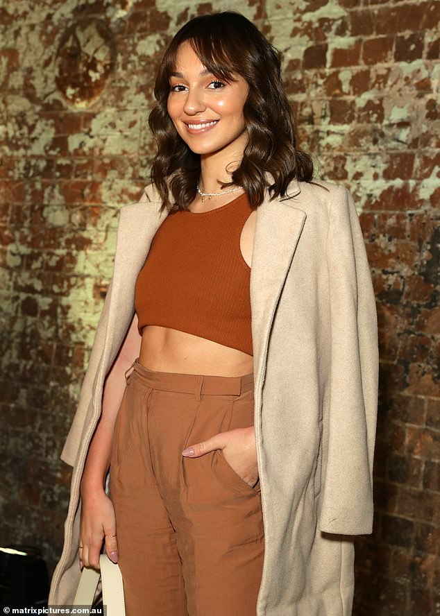 Top of the crops: Bachelor runner-up Bella Varelis flaunted her toned torso in a midriff top as she stepped out for the Oroton show, on Tuesday for Australian Fashion Week