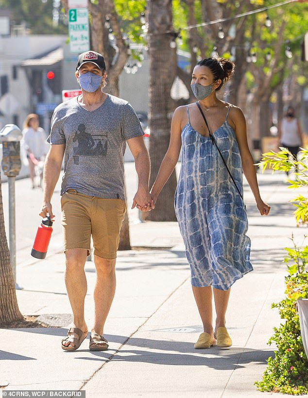 Matthew's look:Morrison was wearing a grey t-shirt and brown shorts for the afternoon walk with his wife