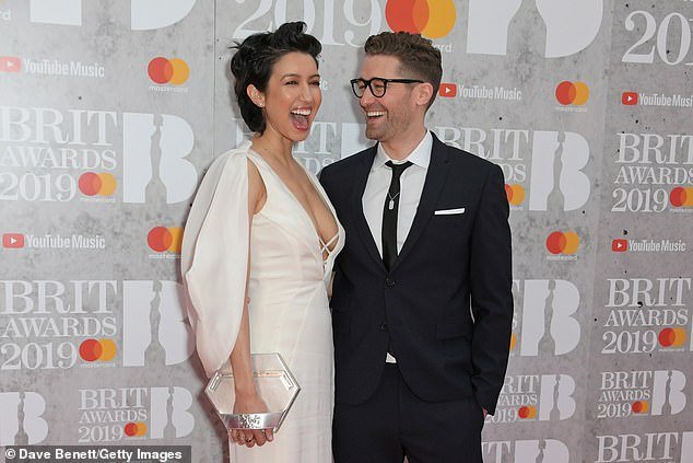 Happy couple:Morrison and Renee Puente started dating in 2011, with the couple announcing their engagement in June 2013, with some help from Elton John
