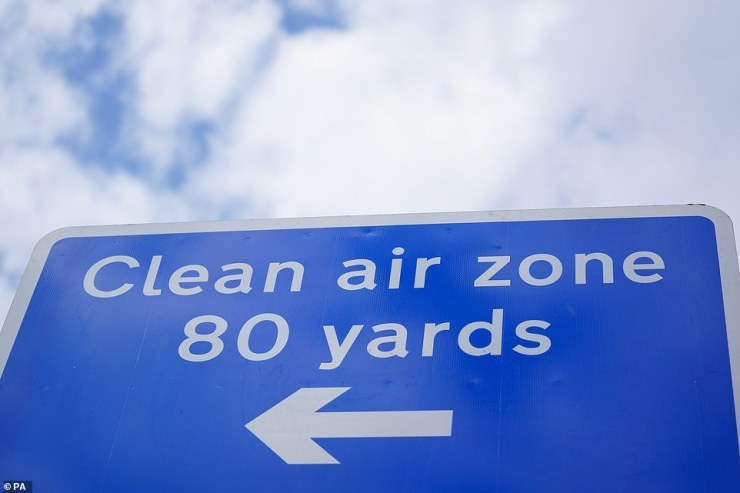 Signs in Birmingham informing road users of the clean air zone initiative, which came into place today