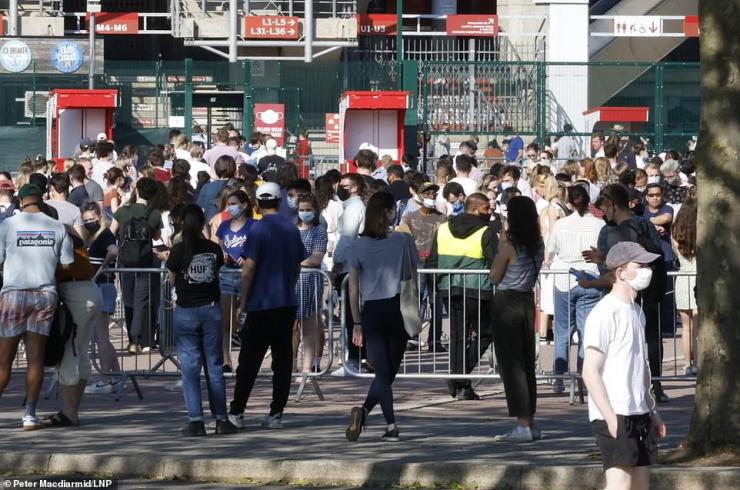 Queues, described by some 'as long as those to get into Glastonbury', are tonight forming outside Twickenham Stadium in west London as people rush to get their Covid jab