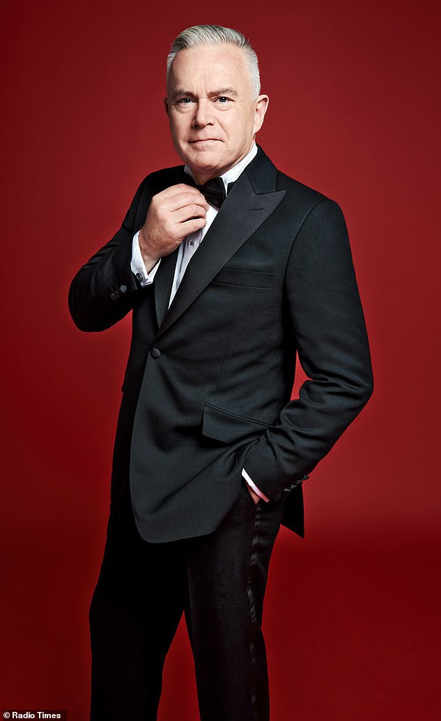 Sleek!Huw Edwards looked incredibly suave as he donned a tuxedo for the shot