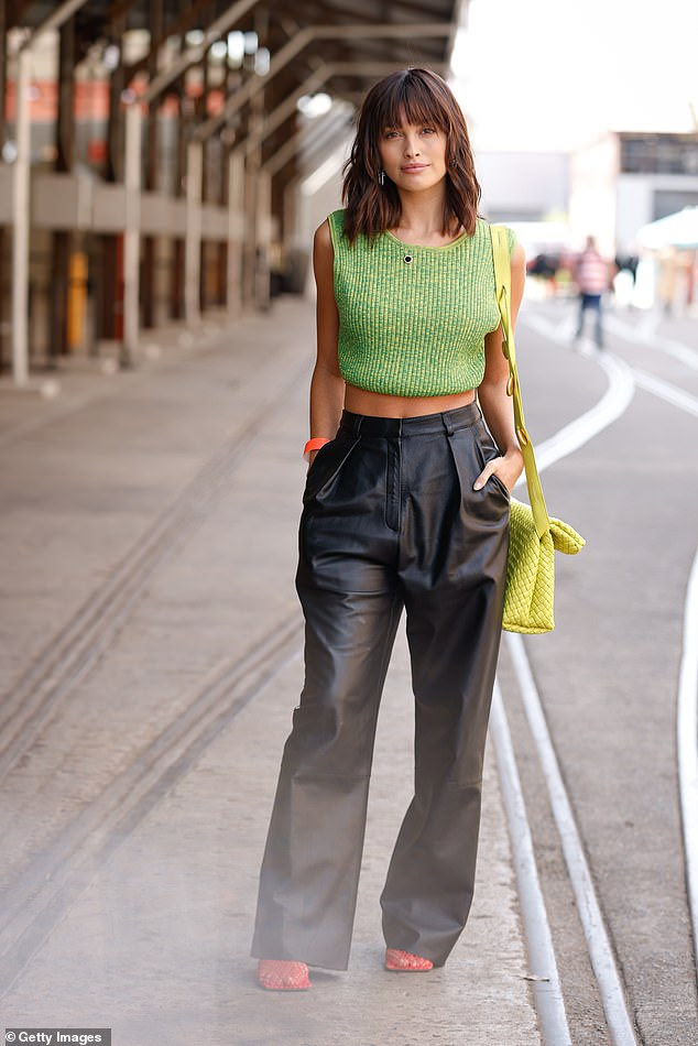 Bag it:She accessorised with a yellow, thatched Bottega Veneta shoulder bag and red heels from the same label