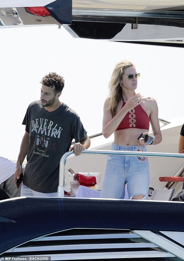 Party:The Australian Formula One Driver, 31, was onboard a yacht near Formentera, one of Spain's Balearic Islands in the Mediterranean Sea