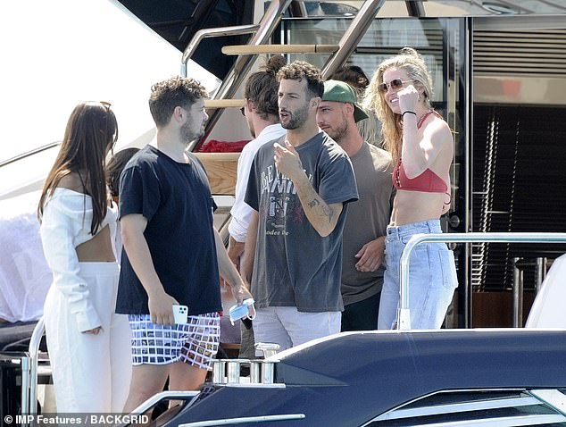 Casual:She paired the swimwear with a pair of pale, blue jeans and shielded her eyes with sunglasses