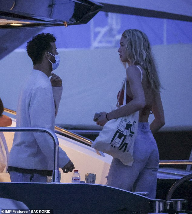 Chats: Daniel and his blonde friend talked on the deck of the boat