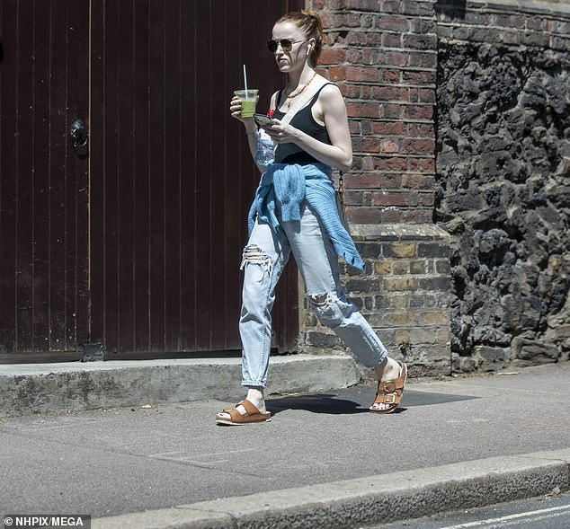 Laid-back look: Bridgerton star Phoebe Dynevor cut a relaxed figure on Tuesday in a Fiorucci vest and distressed jeans as she grabbed a juice drink in central London