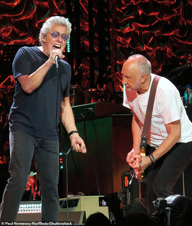 Guitar hero: The rocker, seen here with The Who singer Roger Daltrey, rose to fame as a member of The Who and he was known for smashing his guitars on stage