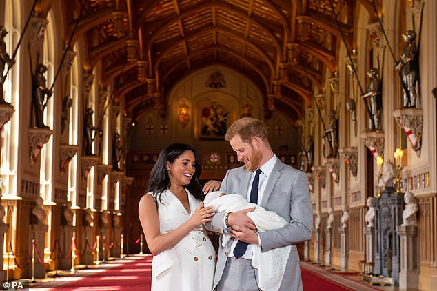 The couple appeared to be beside themselves with joy, giggling and looking into each other's eyes as they spoke, while Harry could not resist sneaking a peek down at his son as he apparently slept