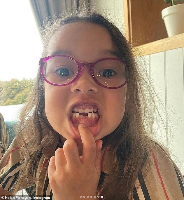 Tooth fairy time: Helen's eldest daughter Matilda had a big moment of her own while on the family trip as she proudly displayed the tooth she'd lost in a gap-toothed snap