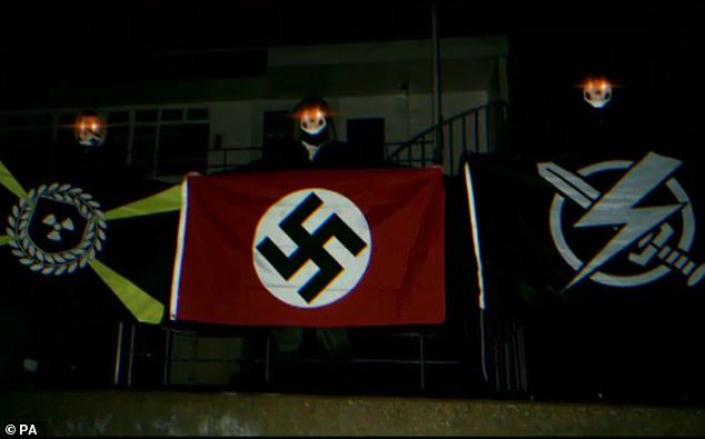 Jurors were previously shown this image of a figure holding a swastika flag which was recovered from devices belonging to Dymock