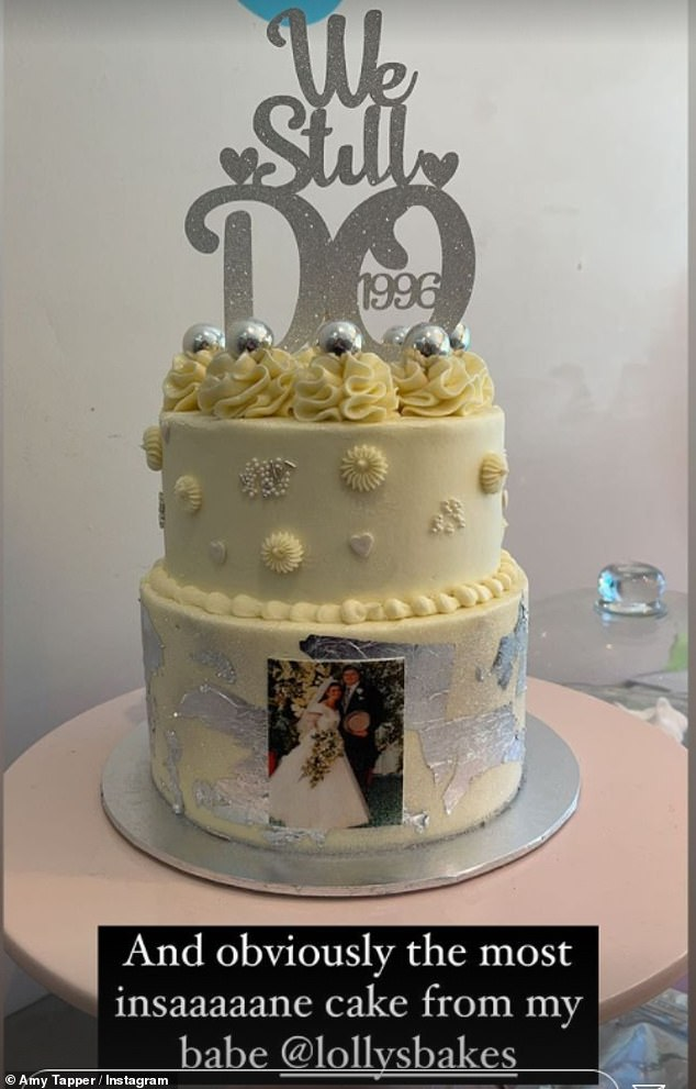 Thoughtful: A multi-tiered cake was also baked for the party, featuring a large silver '25' on the top and a picture of Nikki and Jonathan on their wedding day on the front