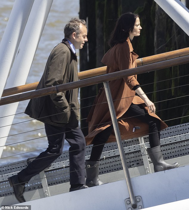 Scenes: Eva and her male co-star were seen engaging in a deep conversation before she then walked ahead of him up a ramp