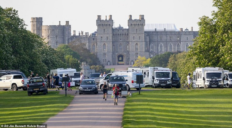 The group parked vehicles and up to 30 caravans and motorhomes outside famous Windsor Castle yesterday (pictured) - widely regarded as the Queen's favourite royal residence and the one in which she is currently staying