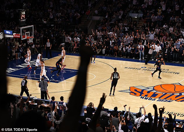 A basketball game between the New York Knicks and Atlanta Hawks at Madison Square Garden last month had sections of the stadium for vaccinated fans, which required no masks or social distancing, while precautionary measures will still needed in the sparsely populated unvaccinated sections (above)