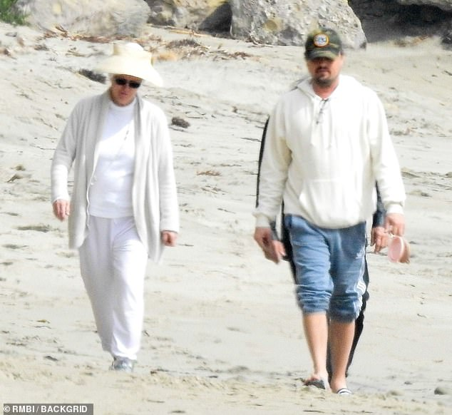 Family affair:The couple, who have been romantically linked since 2017, were joined by DiCaprio's father George and his wife Peggy Ann Farra