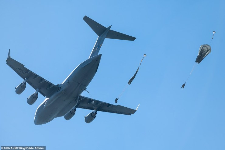 A U.S. Air Force C-17 Globemaster III aircraft assigned to the 437th Airlift Wing, Joint Base Charleston, South Carolina, drops Air Force and U.S. Army paratroopers onto Cheshnegirovo Airfield in Bulgaria, during exercise Swift Response 21 on May 11, 2021