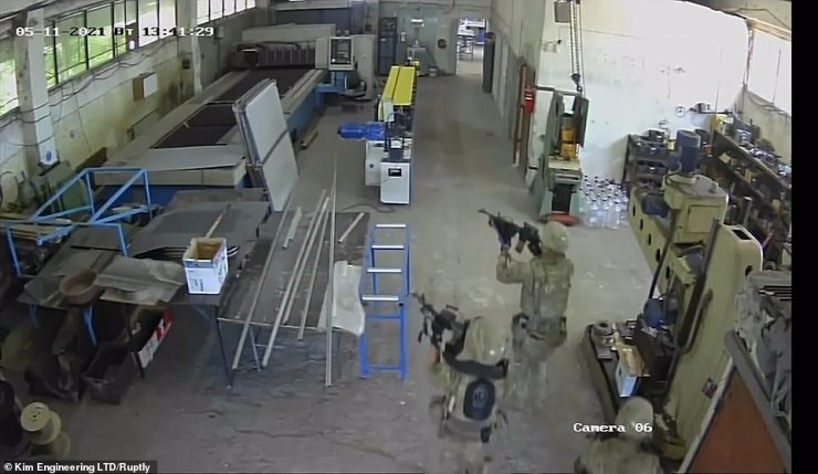Soldiers wereseen storming the factory with their weapons drawn while at least one worker was inside