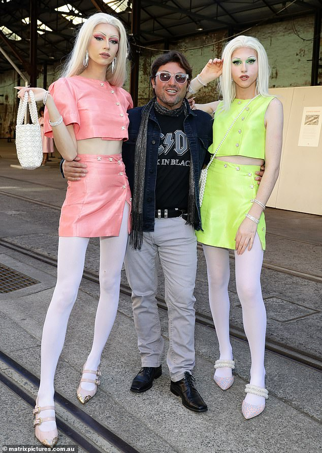 Glamazons: Nasser Sultan certainly looked every inch the star on Wednesday, when he attended Afterpay Australian Fashion Week flanked by two statuesque blondes