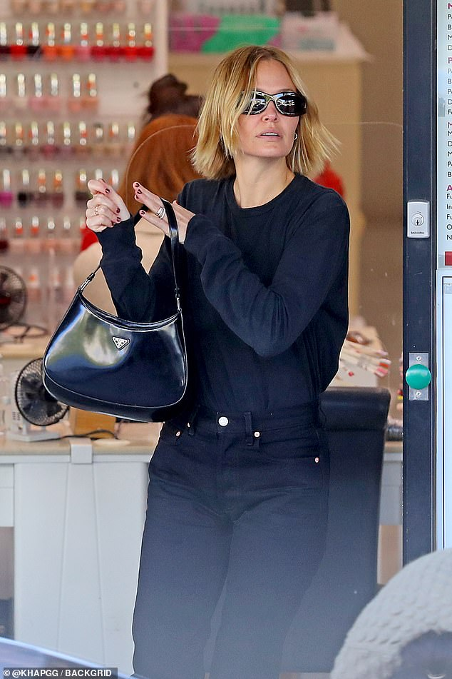 Stylish:The 33-year-old looked chic in an all black ensemble consisting of black jeans and a long-sleeved shirt