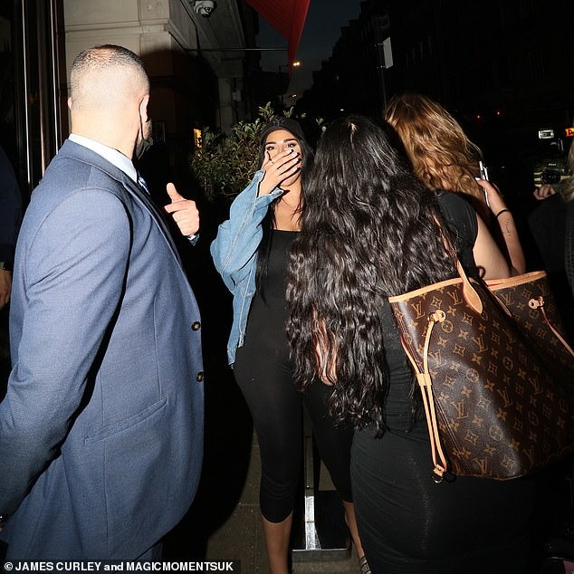 Time to go:And it appears their exchange with the security guard proved fruitless as they shortly left the venue, with a high-spirited Anna being escorted to a waiting car by a friend