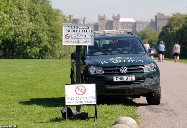 Two cars were seen parked at the entrance to the grounds today, with one marked as a 'warden' (pictured)