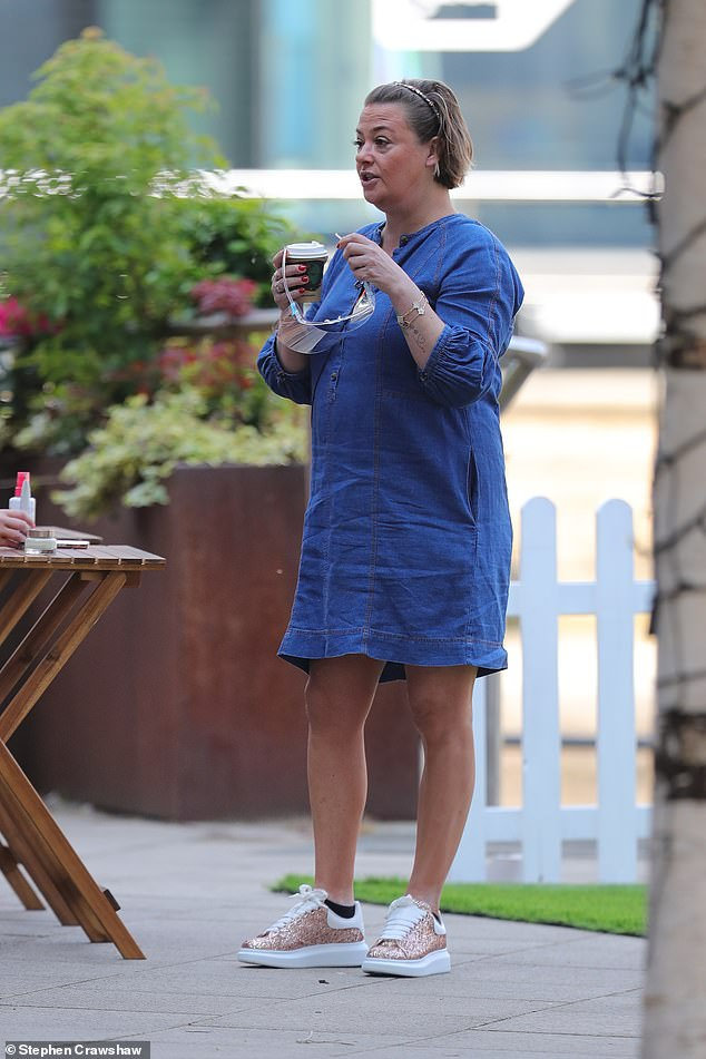 Outfit:The makeup artist, 44, opted for a laid back look, sporting a blue long-sleeved mini dress which she paired with white and pink trainers