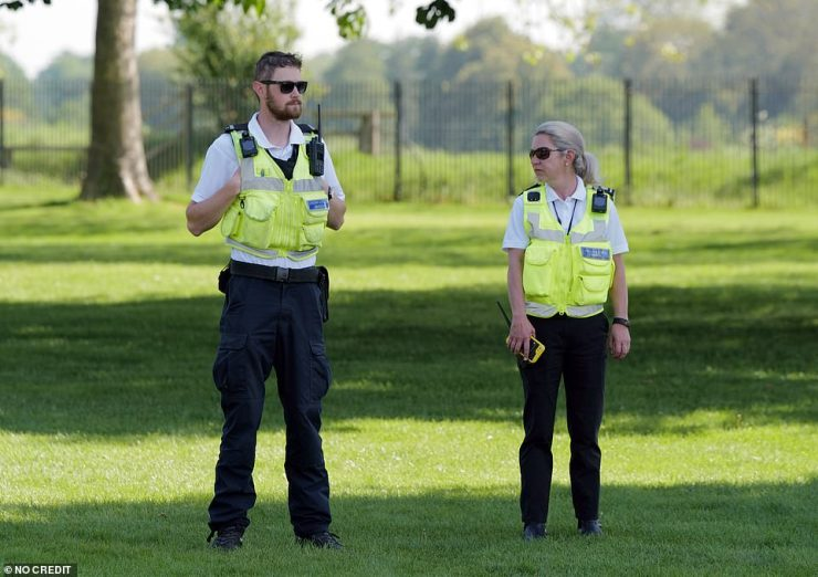 Two officials with walkie talkies are seen standing at the Long Walk in Windsor today. It comes after travellers moved into the area yesterday but swiftly cleared off