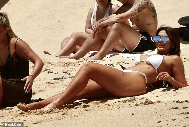 Glamazon: Chloe oozed glamour in her beach day get-up as she relaxed in the sunshine