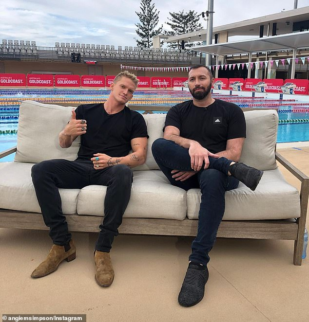Lounging poolside:Cody Simpson was all smiles as he posed with Olympic legend Ian Thorpe ahead of the premiere of their new documentary series Head Above Water