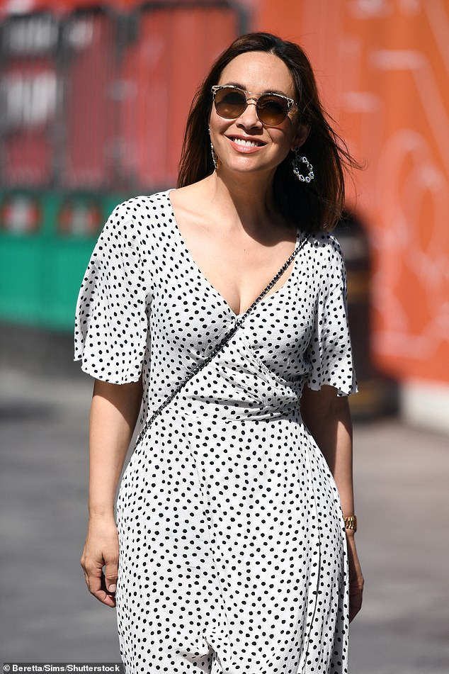 Stunning: The radio host, 43, boosted her height with tan wedges as she strolled through Leicester Square ahead of her afternoon Smooth FM show