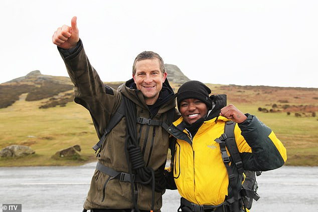 There she is:The boxing champ, 38, was no doubt unmissable as she donned a bright yellow jacket as she and Bear, 46, filmed the gruelling scenes in Dartmoor