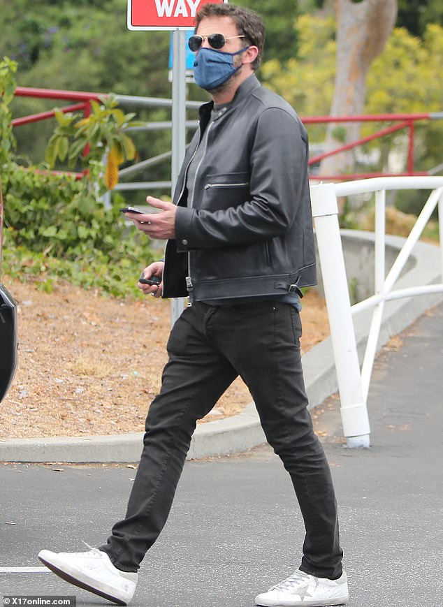 Looking fab:Ben Affleck was spotted looking stylish as ever in a dark outfit and aviator shades as he stepped out in Los Angeles on Tuesday