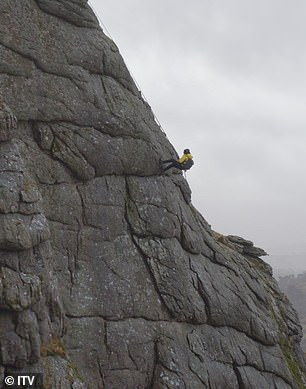 Don't look down! While the two are also seen abseiling down a cliff edge at a great height