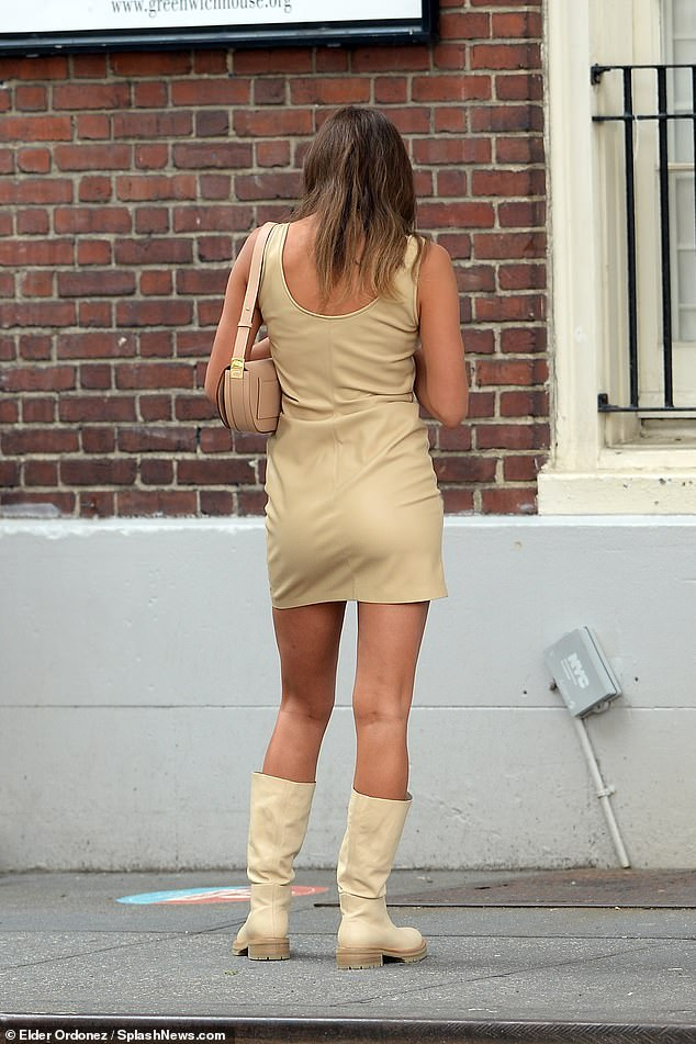These boots were made for walking! Shayk teamed her fitted dress with a matching pair of knee-high boots