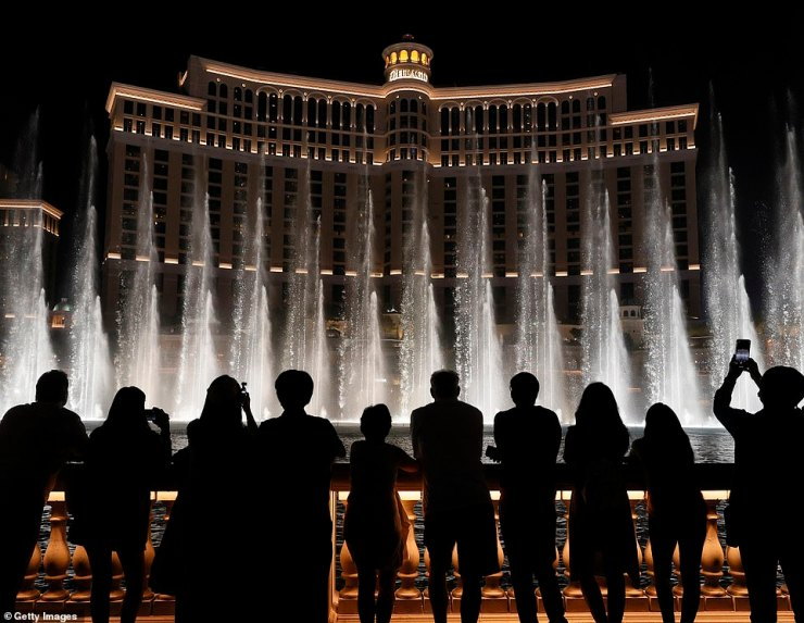 Visitors are silhouetted as they watch The Fountains of Bellagio on May 31 in Las Vegas, Nevada