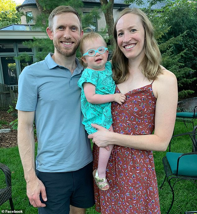 Emma Peterka, two, from Minnetonka, Minnesota, has been diagnosed with 'childhood Alzheimer's.' Pictured: Emma (center) with her parents, Mitch and Sara