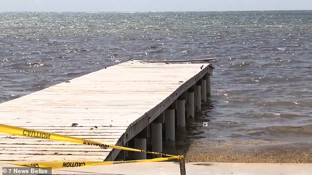 Police believe Jemmott and Hartin had been drinking and toying around with his service weapon before it accidentally fired, hitting him in the head and causing him to topple off a pier (pictured) in the luxury coastal enclave of Ambergris Caye