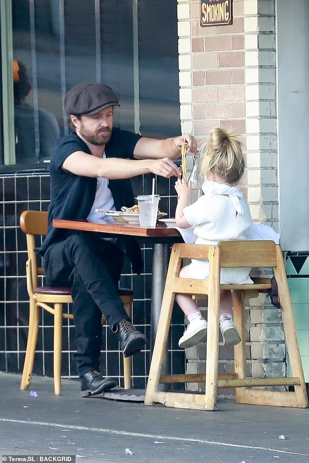 Sweet: Aaron Paulenjoyed a sweet daddy daughter lunch date with his three-year-old daughter Story in the Los Feliz neighborhood of Los Angeles on Tuesday
