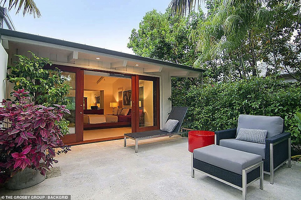 Lounge:Out back is perfect for entertaining guests, boasting a water feature and fire pit on the patio